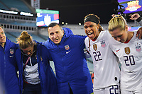JACKSONVILLE, FL - NOVEMBER 10: Alyssa Naeher #1, Vlatko Andonovski, Jessica McDonald #22 and Allie Long #20 of the United States celebrate their victory during a game between Costa Rica and USWNT at TIAA Bank Field on November 10, 2019 in Jacksonville, Florida.