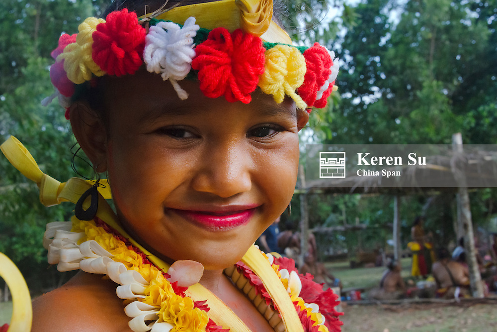 Girl in traditional dress with palm tree, Palau Stock