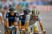 HTC Columbia team rider Maxime Monfort pushing hard at the front of the peleton on the Champs Elysees, Paris, France