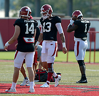 Arkansas quarterbacks Cade Pearson (from left), Feleipe Franks and KJ Jefferson line up on the line of scrimmage Tuesday, Sept. 8, 2020, during practice at the university football practice fields in Fayetteville. Visit nwaonline.com/200909Daily/ for today's photo gallery.<br /> (NWA Democrat-Gazette/Andy Shupe)