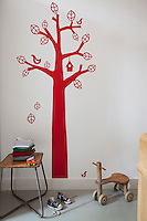 """In this children's bedroom is a """"Bird Tree"""" wall sticker from Ferm Living"""