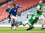 St Johnstone v Hibs…22.05.21  Scottish Cup Final Hampden Park<br />Glenn Middleton is tackled by Paul Hanlon<br />Picture by Graeme Hart.<br />Copyright Perthshire Picture Agency<br />Tel: 01738 623350  Mobile: 07990 594431