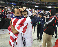 Landon Donovan congratulates Jonathan Bornstein after a 2-2 tie with Costa Rica to put the USA in first place of .CONCACAF 2010 World Cup qualifying, at RFK Stadium, in Washington DC, Wednesday, October 14, 2009.
