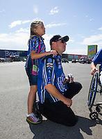 Jul. 27, 2014; Sonoma, CA, USA; NHRA funny car driver Robert Hight and his daughter Autumn Hight during the Sonoma Nationals at Sonoma Raceway. Mandatory Credit: Mark J. Rebilas-