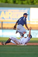 Pensacola Blue Wahoos second baseman Ryan Wright (6) throws to first as KD Kang (12) slides in during a game against the Mississippi Braves on May 27, 2015 at Trustmark Park in Pearl, Mississippi.  Pensacola defeated Mississippi 7-5 in fourteen innings.  (Mike Janes/Four Seam Images)