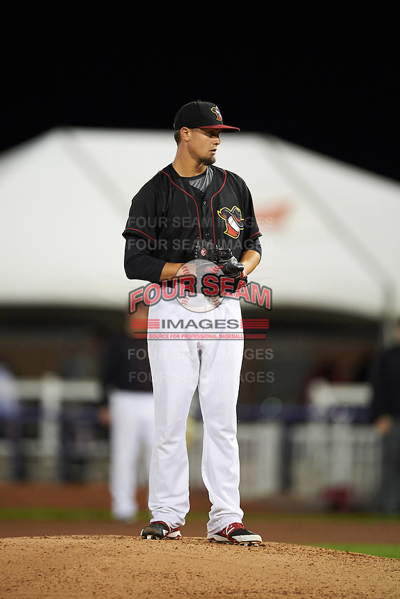 Quad Cities River Bandits pitcher Dean Deetz (22) gets ready to deliver a pitch during the second game of a doubleheader against the Wisconsin Timber Rattlers on August 19, 2015 at Modern Woodmen Park in Davenport, Iowa.  Quad Cities defeated Wisconsin 8-1.  (Mike Janes/Four Seam Images)