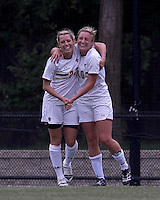 Boston College forward Stephanie Wirth (22) celebrates her goal with teammate. Boston College defeated North Carolina State,1-0, on Newton Campus Field, on October 23, 2011.