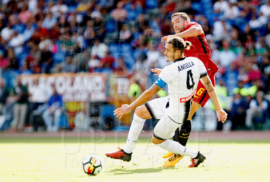 Calcio, Serie A: Roma vs Udinese. Roma, stadio Olimpico, 23 settembre 2017.<br /> Roma's Kevin Strootman, right, is challenged by Udinese's Gabriele Angella during the Italian Serie A football match between Roma and Udinese at Rome's Olympic stadium, 23 September 2017. Roma won 3-1.<br /> UPDATE IMAGES PRESS/Riccardo De Luca