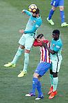 Atletico de Madrid's Fernando Torres (c) and FC Barcelona's Gerard Pique (l) and Samuel Umtiti during La Liga match. February 26,2017. (ALTERPHOTOS/Acero)