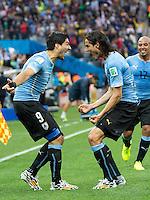 Luis Suarez of Uruguay celebrates scoring a goal with Edinson Cavani after making it 1-0
