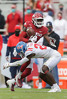 Arkansas wide receiver Mike Woods (8) carries the ball, Saturday, October 17, 2020 during the second quarter of a football game at Donald W. Reynolds Razorback Stadium in Fayetteville. Check out nwaonline.com/201018Daily/ for today's photo gallery. <br /> (NWA Democrat-Gazette/Charlie Kaijo)
