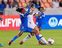 HOUSTON, TX - JANUARY 28: Ruthny Mathurin #4 of Haiti tries to tackle Lynn Williams #13 of the United States during a game between Haiti and USWNT at BBVA Stadium on January 28, 2020 in Houston, Texas.