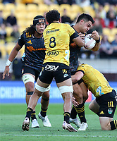 20th March 2021; Wellington, New Zealand;  Chiefs Quinn Tupaea is tackled by Hurricanes Ardie Savea. Super Rugby Aotearoa. Hurricanes v Chiefs. Sky Stadium, Wellington. Saturday 20th March 2021.