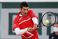 11th October 2020, Roland Garros, Paris, France; French Open tennis, mens singles final 2020; Novak Djokovic of Serbia hits a return during the mens singles final match against Rafael Nadal of Spain at the French Open tennis tournament