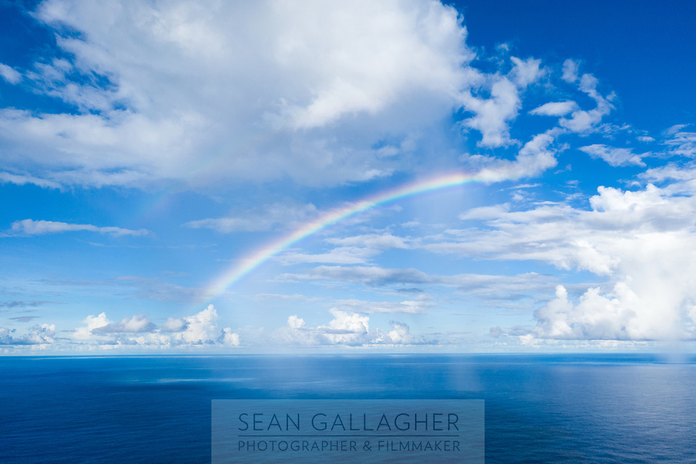 A rainbow hangs over the Pacific Ocean, just of off the coastline of Funafuti, Tuvalu. March, 2019.