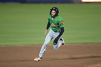 Jayce Easley (3) of the Down East Wood Ducks hustles towards third base against the Kannapolis Cannon Ballers at Atrium Health Ballpark on May 5, 2021 in Kannapolis, North Carolina. (Brian Westerholt/Four Seam Images)