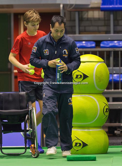 Rotterdam,Netherlands, December 17, 2015,  Topsport Centrum, Lotto NK Tennis, Wheelchair Tennis, Linesman changing balls<br /> Photo: Tennisimages/Henk Koster