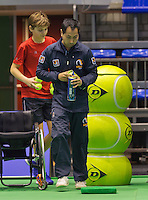 Rotterdam,Netherlands, December 17, 2015,  Topsport Centrum, Lotto NK Tennis, Wheelchair Tennis, Linesman changing balls<br /> Photo: Tennisimages/Henk Koster