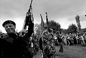 Gornja Klina, Kosovo  <br /> 1999<br /> <br /> KLA (UCK) fires off round after round from their weapons at the top of a hill. Residents cheer them on as they celebrate the departure of the Serb military from the region the night before.