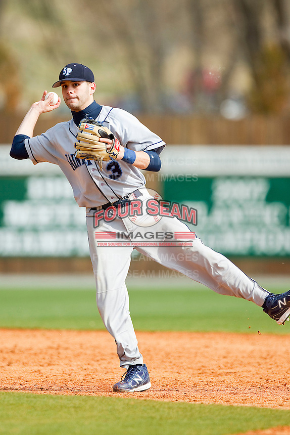 Shortstop Alberto Rodriguez #3 of the Saint Peter's Peacocks makes an off-balance throw to first base against the Charlotte 49ers at Robert and Mariam Hayes Stadium on February 18, 2012 in Charlotte, North Carolina.  Brian Westerholt / Four Seam Images