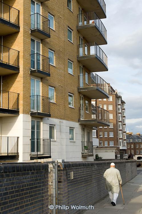 A Muslim man walks past an apartment block in Marylebone, London.