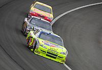 Feb 22, 2009; Fontana, CA, USA; NASCAR Sprint Cup Series driver Mark Martin (5) leads A.J. Allmendinger (44) and Marcos Ambrose during the Auto Club 500 at Auto Club Speedway. Mandatory Credit: Mark J. Rebilas-
