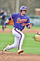 Clemson Tigers left fielder Seth Beer (28) runs to third base during a game against the Notre Dame Fighting Irish at Doug Kingsmore Stadium on March 11, 2017 in Clemson, South Carolina. The Tigers defeated the Fighting Irish 6-5. (Tony Farlow/Four Seam Images)