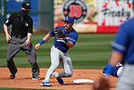 Gavin Lux makes a play during a spring training game between the Texas Rangers and Los Angeles Dodgers in Surprise, Ariz., on Sunday, March 7, 2021.<br /> Photo by Cathleen Allison
