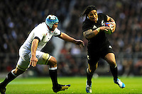 Ma'a Nonu of New Zealand looks to go round Ben Morgan of England during the QBE Autumn International match between England and New Zealand at Twickenham on Saturday 16th November 2013 (Photo by Rob Munro)