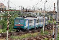- regional train near Greco-Pirelli railroads station ....- treno regionale per pendolari nei pressi della stazione delle ferrovie di Greco-Pirelli