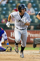 Omaha Storm Chasers second baseman Johnny Giavotella #9 runs to first base during the Pacific Coast League baseball game against the Round Rock Express on July 22, 2012 at the Dell Diamond in Round Rock, Texas. The Express defeated the Chasers 8-7 in 11 innings. (Andrew Woolley/Four Seam Images).