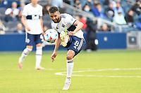 KANSAS CITY, KS - MAY 16: Caio Alexandre #8 Vancouver Whitecaps passes the ball during a game between Vancouver Whitecaps and Sporting Kansas City at Children's Mercy Park on May 16, 2021 in Kansas City, Kansas.