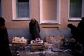 """Moscow, Russia<br /> Soviet Union<br /> December 11, 1991<br /> <br /> An elderly woman sells goods along a street side in central Moscow in the early morning. A very common scene in Moscow just after the break up of the former Soviet Union. <br /> <br /> In December 1991, food shortages in central Russia had prompted food rationing in the Moscow area for the first time since World War II. Amid steady collapse, Soviet President Gorbachev and his government continued to oppose rapid market reforms like Yavlinsky's """"500 Days"""" program. To break Gorbachev's opposition, Yeltsin decided to disband the USSR in accordance with the Treaty of the Union of 1922 and thereby remove Gorbachev and the Soviet government from power. The step was also enthusiastically supported by the governments of Ukraine and Belarus, which were parties of the Treaty of 1922 along with Russia.<br /> <br /> On December 21, 1991, representatives of all member republics except Georgia signed the Alma-Ata Protocol, in which they confirmed the dissolution of the Union. That same day, all former-Soviet republics agreed to join the CIS, with the exception of the three Baltic States."""