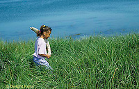 AC35-005z  Girl collecting drift wood at salt marsh