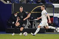 Lukas Klostermann (Deutschland Germany) gegen Ranar Sigurjonsson (Island Iceland) - 25.03.2021: WM-Qualifikationsspiel Deutschland gegen Island, Schauinsland Arena Duisburg