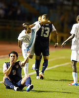 The USA's (9) Herculez Gomez complains about a foul as Guatemala's (11) Jose Contreras and the USA's (13) Jermaine Jones get tangled up as the United States played Guatemala at Estadio Mateo Flores in Guatemala City, Guatemala in a World Cup Qualifier on Tue. June 12, 2012.