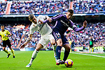 Ruben Alcaraz Jimenez of Real Valladolid (R) is tackled by Toni Kroos of Real Madrid during the La Liga 2018-19 match between Real Madrid and Real Valladolid at Estadio Santiago Bernabeu on November 03 2018 in Madrid, Spain. Photo by Diego Souto / Power Sport Images