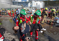 "Paramedics tend to ""victims"" and firefighters put out a fire in an oil facility. HarbourEx15, a field training exercise with scenarios connected to operations in the harbor April 27th – 29th 2015.<br />