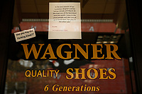 A sign posted at Wagner's Shoes on Butler Street is shown on Friday March 20, 2020 in the Lawrenceville neighborhood of Pittsburgh, Pennsylvania. (Photo by Jared Wickerham/Pittsburgh City Paper)
