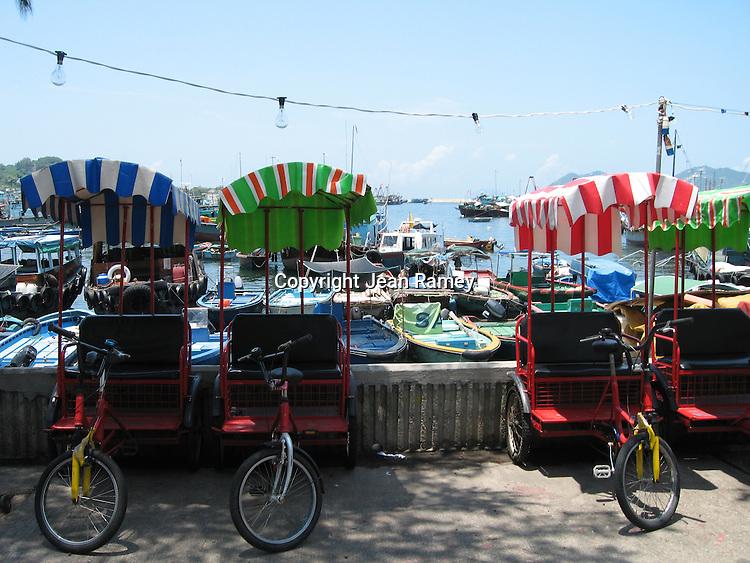 Colorful rickshaws in Cheung Chau's fishing village near Hong Kong