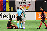 ATLANTA, GA - AUGUST 22: Fernando Meza #6, Brad Guzan #1, and Ted Unkel discuss a call during a game between Nashville SC and Atlanta United FC at Mercedes-Benz Stadium on August 22, 2020 in Atlanta, Georgia.