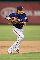 Minnesota Twins shortstop Tsuyoshi Nishioka #1 prepares to make a throw to first base during a Major League Baseball game against the Texas Rangers at the Rangers Ballpark in Arlington, Texas on July 27, 2011. Minnesota defeated Texas 7-2.  (Andrew Woolley/Four Seam Images)