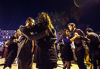 Coppie ballano il tango all'aperto nei giardini di Piazza Vittorio in occasione della Milonga della Liberazione, a Roma, 24 aprile 2015.<br /> Couples dance tango in an outdoor milonga to celebrate the Italian Liberation Day, in Rome, 24 April 2015.<br /> UPDATE IMAGES PRESS/Riccardo De Luca