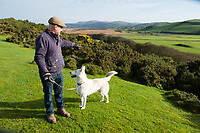 Pictured: Co-owner dean Tweedy with Alsatian Husky dog Benji looking for the lynx near at Borth Wild Animal Kingdom (formerly Borth Animalarium) , Ceredigion Wales UK. Monday 30 October 2017<br /> Re: The search continues for Lillith, a juvenile European Lynx, (latin name Lynx Lynx) which escaped from its enclosure at Both Wild Animal Kingdom.  A police helicopter with thermal imaging cameras spotted the animal  in undergrowth near the zoo in the  3early evening yesterday, raising hopes that the creature has gone to ground close to its home