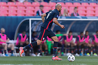DENVER, CO - JUNE 3: John Brooks #6 of the United States moves with the ball during a game between Honduras and USMNT at EMPOWER FIELD AT MILE HIGH on June 3, 2021 in Denver, Colorado.