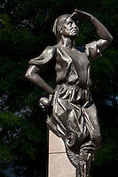 "This statue on Charlotte's Trade and Tryon streets Square is one of four standing on each corner of the intersection. The sculptures were created by artist Raymond Kaskey and are titled ""Transportation,"" ""Future,"" ""Commerce,"" and ""Industry."" This statue, Industry, is symbolized by a woman in a bonnet, who represents the area's early industry."