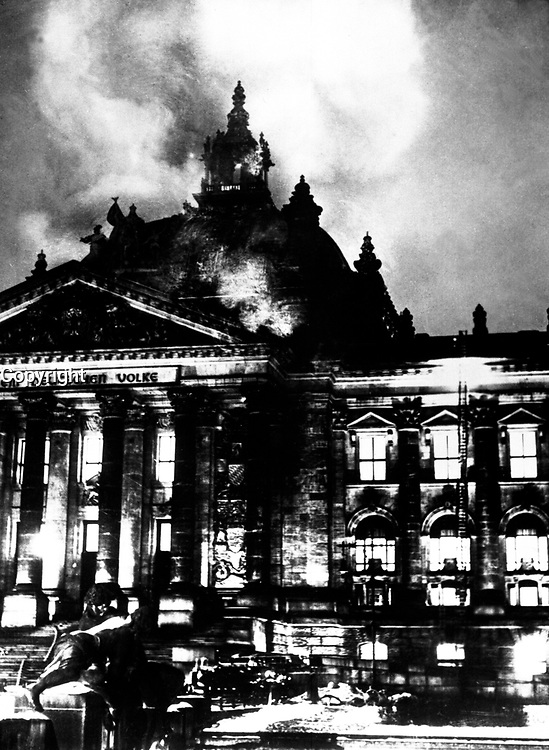 "Firemen work on the burning Reichstag Building in February 1933, after fire broke out simultaneously at 20 places.  This enabled Hitler to seize power under the pretext of ""protecting"" the country from the menace to its security.  Berlin.  Acme.  (OWI)<br /> Exact Date Shot Unknown<br /> NARA FILE #:  208-N-39835<br /> WAR & CONFLICT BOOK #:  987"