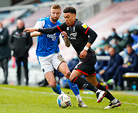 1st May 2021; Weston Homes Stadium, Peterborough, Cambridgeshire, England; English Football League One Football, Peterborough United versus Lincoln City; Morgan Rogers of Lincoln City takes on Mark Beevers of Peterborough United