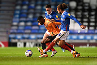 Olamide Shodipo of Oxford United  under pressure from Callum Johnson and Marcus Harness of Portsmouth during Portsmouth vs Oxford United, Sky Bet EFL League 1 Football at Fratton Park on 24th November 2020