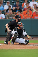 Umpire Mitch Leikam and Delmarva Shorebirds catcher Adley Rutschman (37) await the pitch during a South Atlantic League game against the Greensboro Grasshoppers on August 21, 2019 at Arthur W. Perdue Stadium in Salisbury, Maryland.  Delmarva defeated Greensboro 1-0.  (Mike Janes/Four Seam Images)